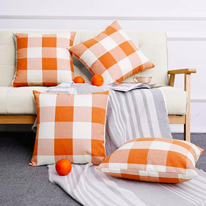 orange buffalo plaid pillows.png